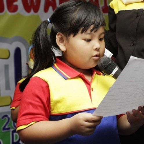 Murid biMBA Taruna Jaya sedang mengikuti pentas baca